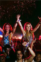 Cheering women on men's shoulders at music festival Stock Photo - Premium Royalty-Freenull, Code: 6113-07564928