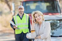 Roadside mechanic behind woman on cell phone Stock Photo - Premium Royalty-Free, Artist: Robert Harding Images, Code: 6113-07564965