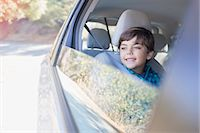 road trip - Happy boy looking out car window Stock Photo - Premium Royalty-Freenull, Code: 6113-07564971