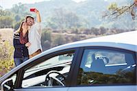 Couple taking self-portrait with cell phone outside car Stock Photo - Premium Royalty-Freenull, Code: 6113-07564999