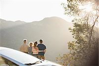 Family looking at mountain view outside car Stock Photo - Premium Royalty-Freenull, Code: 6113-07565018