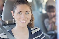Portrait of smiling woman inside car Stock Photo - Premium Royalty-Freenull, Code: 6113-07565068