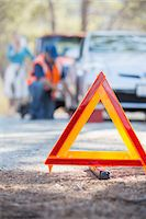 Roadside mechanic helping woman behind warning triangle Stock Photo - Premium Royalty-Freenull, Code: 6113-07565071