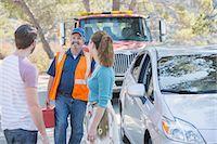 Roadside mechanic arriving to help couple Stock Photo - Premium Royalty-Freenull, Code: 6113-07565073