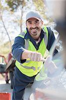 services - Portrait of smiling roadside mechanic Stock Photo - Premium Royalty-Freenull, Code: 6113-07565074