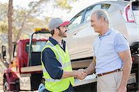 Roadside mechanic and man shaking hands Stock Photo - Premium Royalty-Freenull, Code: 6113-07565078