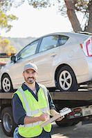 Portrait of confident roadside mechanic with paperwork Stock Photo - Premium Royalty-Freenull, Code: 6113-07565112