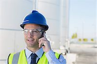 farm phone - Close up of worker talking on cell phone in front of silage storage tower Stock Photo - Premium Royalty-Freenull, Code: 6113-07565340