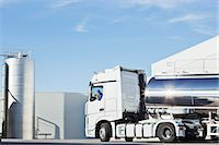 side view tractor trailer truck - Truck driver parking stainless steel milk tanker outside silage storage tower Stock Photo - Premium Royalty-Freenull, Code: 6113-07565356