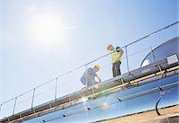 Workers on platform above stainless steel milk tanker Stock Photo - Premium Royalty-Freenull, Code: 6113-07565359