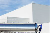 side view tractor trailer truck - Worker climbing ladder at back of stainless steel milk tanker Stock Photo - Premium Royalty-Freenull, Code: 6113-07565403