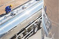 Worker on platform above stainless steel milk tanker Stock Photo - Premium Royalty-Freenull, Code: 6113-07565437