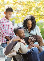 Happy family hugging outdoors Stock Photo - Premium Royalty-Freenull, Code: 6113-07565457