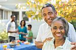 Portrait of smiling senior couple at barbecue