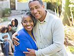 Close up portrait of smiling senior couple hugging outdoors