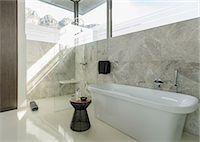 shower - Soaking tub in sunny modern bathroom Stock Photo - Premium Royalty-Freenull, Code: 6113-07565661