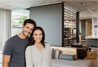 rich lifestyle - Portrait of happy couple in living room Stock Photo - Premium Royalty-Freenull, Code: 6113-07565818