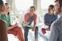 five people - Creative business people meeting in circle of chairs Stock Photo - Premium Royalty-Freenull, Code: 6113-07565874