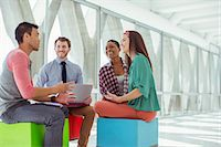 Creative business people meeting on colorful stools Stock Photo - Premium Royalty-Freenull, Code: 6113-07565878