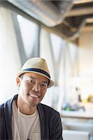 Portrait of smiling casual businessman in fedora Stock Photo - Premium Royalty-Freenull, Code: 6113-07565943
