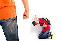 student fighting - school Violence , Students have been injured  and raise hand to stop Stock Photo - Royalty-Freenull, Code: 400-07569863
