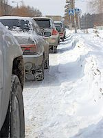Snowy road surface from the back of unrecognizable car Stock Photo - Royalty-Freenull, Code: 400-07573770