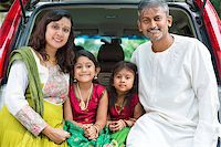 Happy Asian Indian family sitting in car, ready to summer vacation. Stock Photo - Royalty-Freenull, Code: 400-07574752