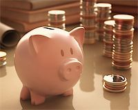 Gold coins and silver around the piggy bank. Stock Photo - Royalty-Freenull, Code: 400-07574971