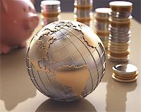 Planet Earth made â??â??of gold and silver on a concept of the business world. Stock Photo - Royalty-Free, Artist: ktsimage, Code: 400-07574972