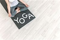 Young girl with the words Yoga Stock Photo - Royalty-Freenull, Code: 400-07580021