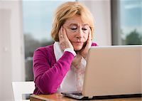 Senior woman working on notebook computer, Germany Stock Photo - Premium Rights-Managednull, Code: 700-07584788