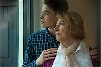 Close-up portrait of teenage boy with grandmother looking out window at home, Germany Stock Photo - Premium Rights-Managed, Artist: Uwe Umstätter, Code: 700-07584804