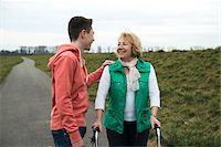 Teenage grandson talking to grandmother using walker on pathway in park, walking in nature, Germany Stock Photo - Premium Rights-Managednull, Code: 700-07584819