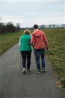 Backview of teenage grandson with grandmother using walker on pathway in park, walking in nature, Germany Stock Photo - Premium Rights-Managednull, Code: 700-07584830