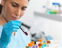 female doctor - Scientist viewing various human samples for testing in the laboratory Stock Photo - Premium Royalty-Freenull, Code: 649-07585099