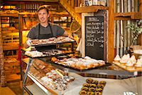 Mature man holding tray of fresh pastries Stock Photo - Premium Royalty-Freenull, Code: 649-07585192