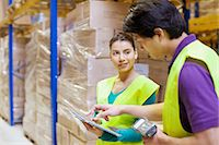piles of work - Male and female workers using digital tablet in distribution warehouse Stock Photo - Premium Royalty-Freenull, Code: 649-07585266