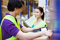 piles of work - Male and female workers chatting in distribution warehouse Stock Photo - Premium Royalty-Freenull, Code: 649-07585267