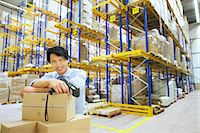 piles of work - Portrait of male manager in distribution warehouse Stock Photo - Premium Royalty-Freenull, Code: 649-07585275