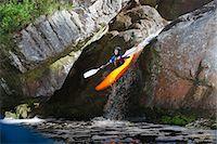Mid adult man kayaking down river waterfall Stock Photo - Premium Royalty-Freenull, Code: 649-07585294