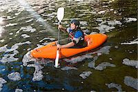 Mid adult man kayaking on peaceful river Stock Photo - Premium Royalty-Freenull, Code: 649-07585295