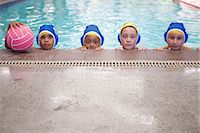 Portrait of three schoolgirl water polo pla