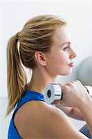 Young woman lifting weights Stock Photo - Premium Royalty-Freenull, Code: 649-07585517