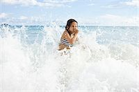 seychelles - Girl playing in sea, holding nose Stock Photo - Premium Royalty-Freenull, Code: 649-07585553