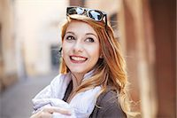 Sophisticated young woman looking back on street Stock Photo - Premium Royalty-Freenull, Code: 649-07585566