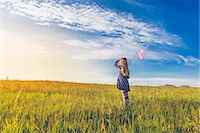 scenic and spring (season) - Girl carrying butterfly net in spring meadows, Reykjavic, Iceland Stock Photo - Premium Royalty-Freenull, Code: 649-07585585