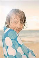 Boy on beach, wrapped in towel Stock Photo - Premium Royalty-Freenull, Code: 649-07585642