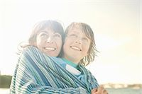 people and vacation - Mother and son wrapped in blanket, on beach Stock Photo - Premium Royalty-Freenull, Code: 649-07585643