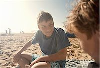pre-teen beach - Boys sitting on beach Stock Photo - Premium Royalty-Freenull, Code: 649-07585655
