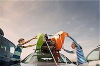 road trip - Mother and son stacking kayaks on top of car Stock Photo - Premium Royalty-Freenull, Code: 649-07585670